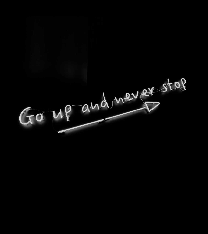 """Leuchtschrift """"go up and never stop"""" - weiß auf schwarz"""